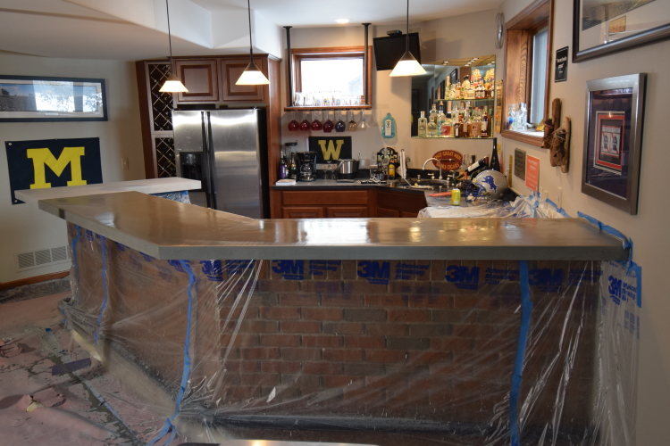 Finished Basement Wood Bar Countertop After Cement Base Coat For Decorative Concrete Overlay