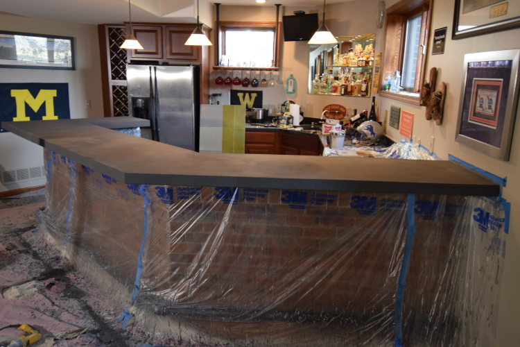 Gray (Not Yet Sealed) Decorative Concrete Overlay of Wood Bar Countertop In Finished Basement