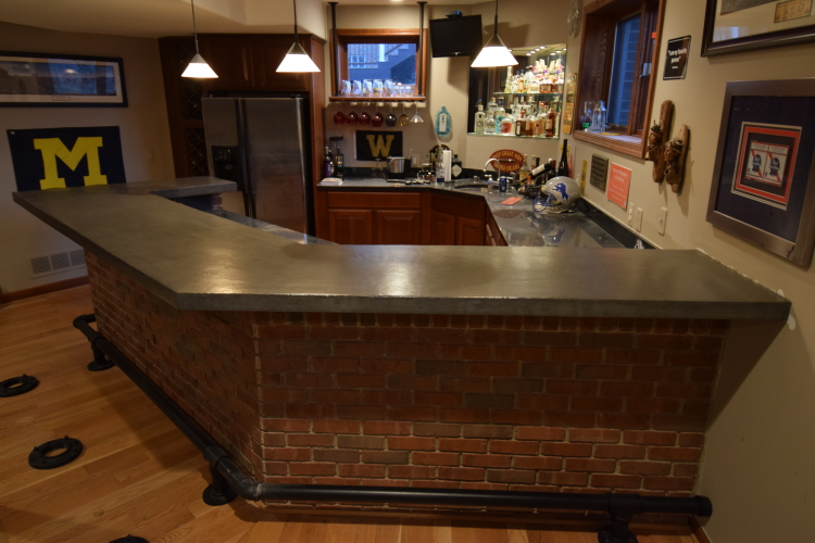 Gray Decorative Concrete Overlay of Wood Bar Countertop In Finished Basement After Applying Clear Epoxy Sealer