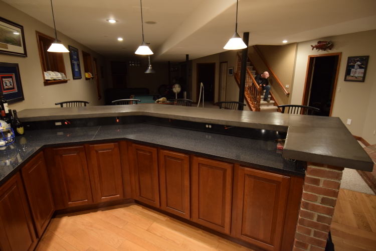 Wood Bar Countertop In Finished Basement Transformed Into Gray Concrete Countertop With Cement Overlay