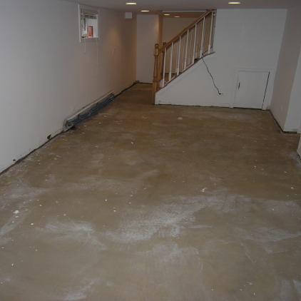 Finished Basement Concrete Floor Before Cleaning And Acid-Staining