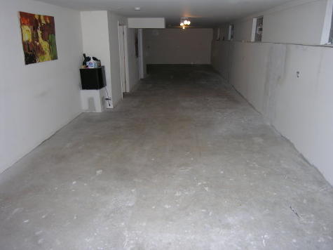 Finished Basement Concrete Floor Prior To Cleaning And Acid-Staining
