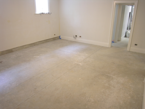 Remodeled Basement Concrete Floor Before Cleaning And Acid-Staining