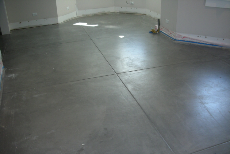 Charcoal Gray Finished Basement New Concrete Floor Sealed Before Paint Spatter Was Removed