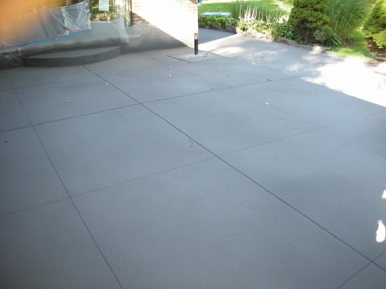 Decorative, Spray Texture Overlay Of Backyard Concrete Patio Before Clear Sealer