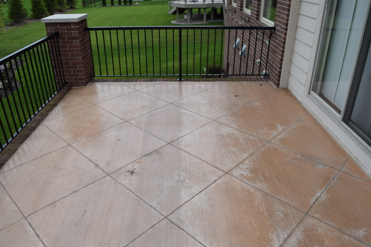 Elevated Backyard Decorative Concrete Terrace With Peeling Clear Sealer