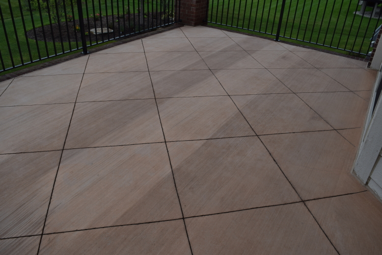 Elevated Backyard Decorative Concrete Terrace With Integral Color Before Sealing