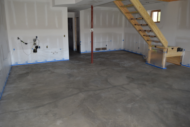 Basement Concrete Floor With Cracks Damp After Cleaning Prior To Acid-Staining
