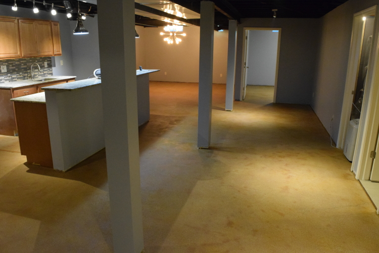 Finished Basement Concrete Floor After Rinsing Excess Acid Stain Residue
