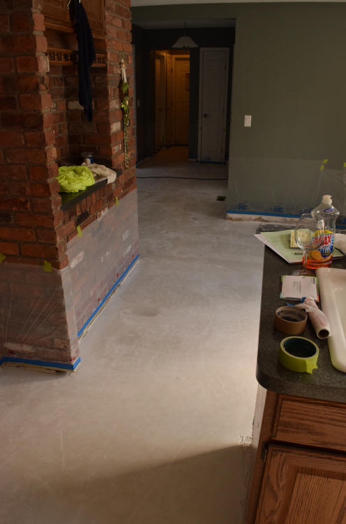 White Cement Overlay Of Kitchen Floor Before Repairs And Acid Staining
