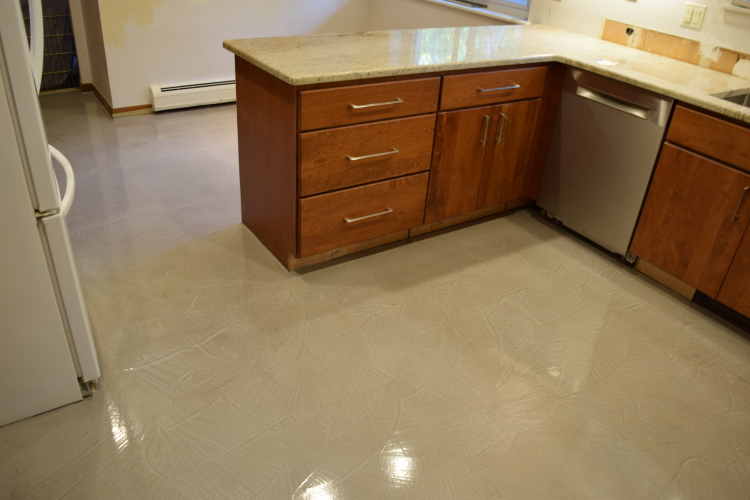 Kitchen Concrete Floor Overlaid With Gray Cement Micro-Topping And Sealed With Water-Based Clear Epoxy