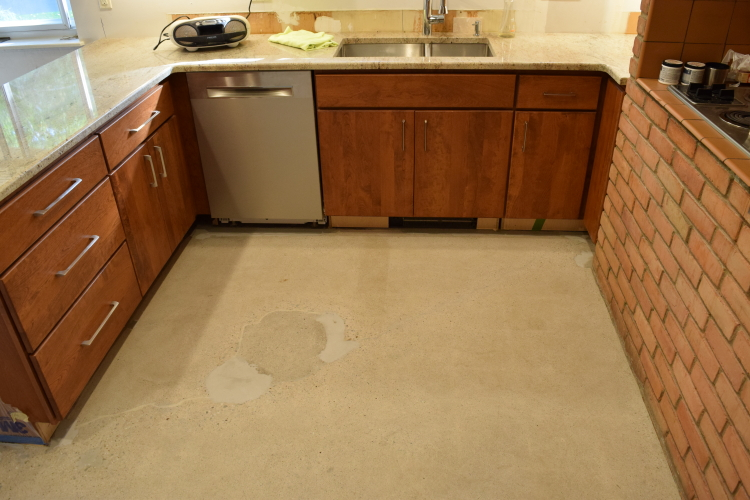 Kitchen Concrete Floor After Grinding, Patching And Crack Repair Before Installing Decorative Cement Overlay