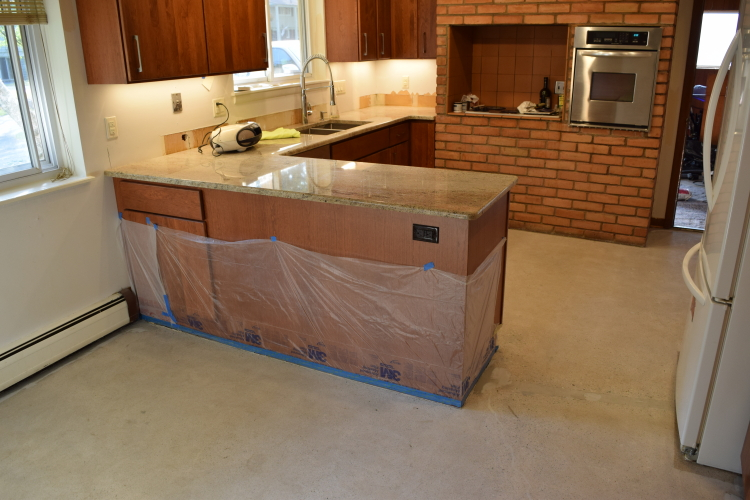 Kitchen And Dinette Concrete Floor After Grinding Tile Adhesive Before Resurfacing With Decorative Cement Overlay