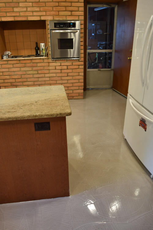 Kitchen Concrete Floor Resurfaced With Gray Decorative Cement Overlay And Sealed With Clear Gloss Epoxy