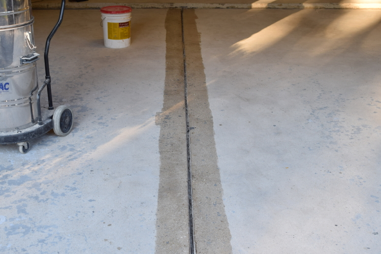 Garage Concrete Floor During Repair And Before Installing New Polyurea Joint Filler