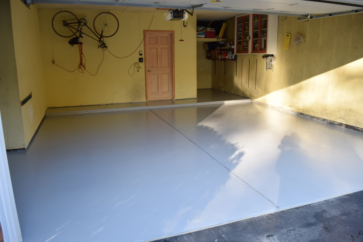 Two-Car Garage Concrete Floor After Installing New, Gray, High Performance Polyurea Coating