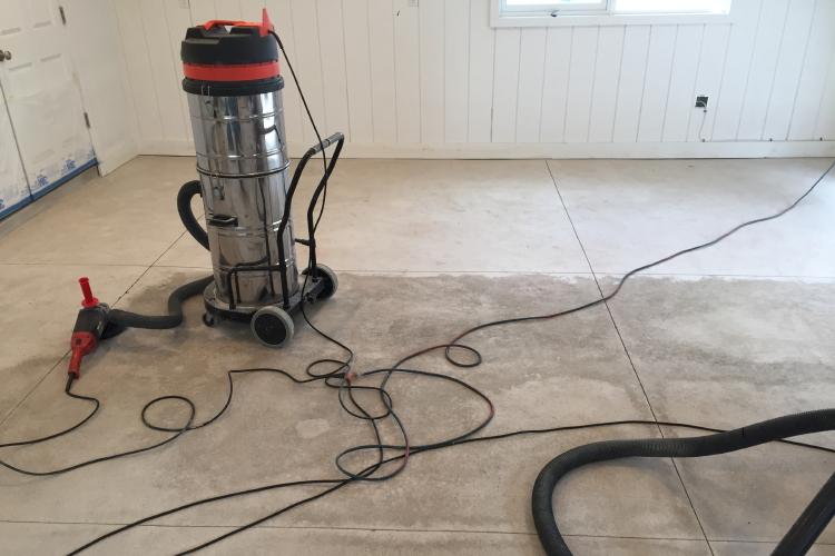 New Garage Damp Concrete Floor During Grinding