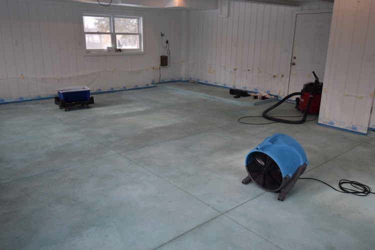 New Garage Concrete Floor Acid-Stained Blue Drying Out Before Applying Sealer