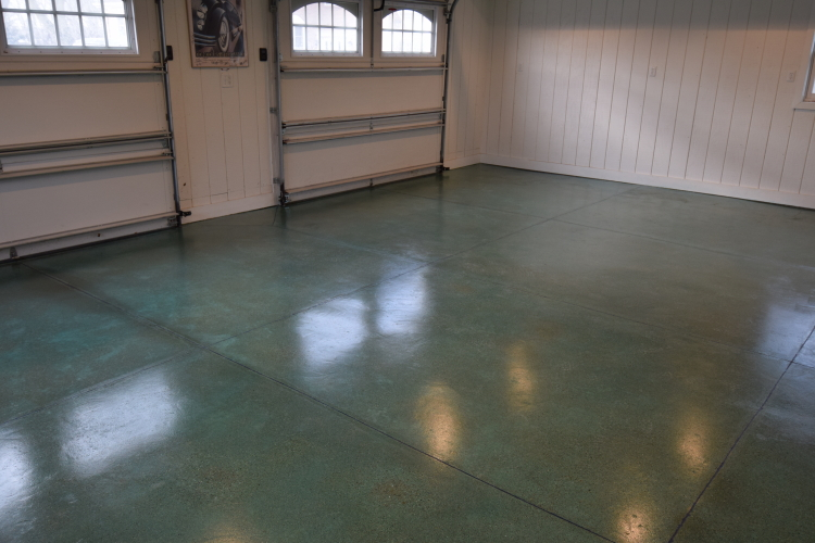 Blue-Green Acid-Stained Garage Concrete Floor With Blue Polyurea Joint Filler And Clear Polyurea Sealer With Anti-Slip Aggregate