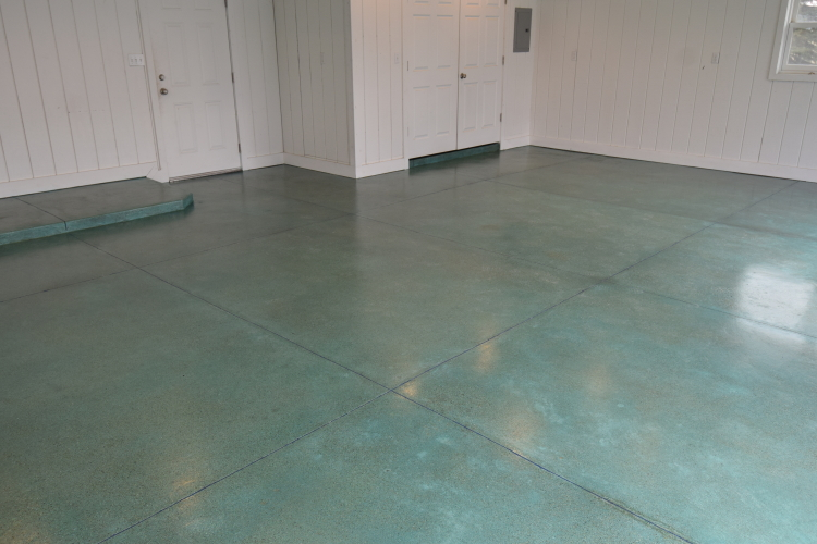 Blue-Green Acid-Stained Garage Concrete Floor With Blue Polyurea Joint Filler And Clear Polyurea Sealer