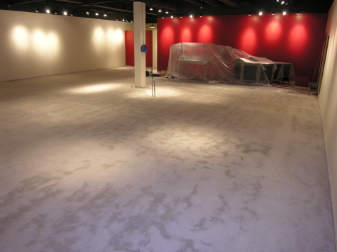 Retail Store Concrete Floor Ground Clean of Adhesive Prior to Acid-Stained Cement Overlay