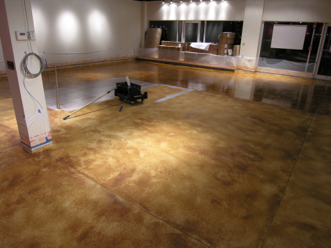 Retail Store Concrete Floor Resurfaced With Cement Overlay and Acid-Stained Before Applying Clear Sealer