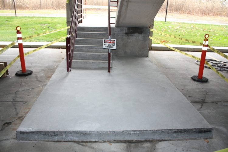Ground Floor of Parking Deck Interior Concrete Stairwell After Surface Prep and Before Coating