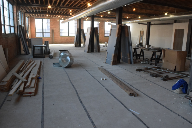 Old Factory Floor in Detroit With Temporary Protective Covering After Installation of New Cement Overlay