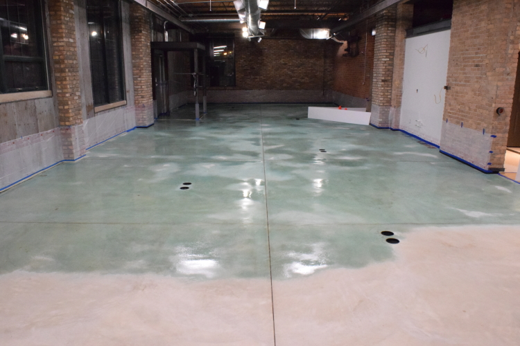 New Concrete Floor In Old Factory During Application of Blue Acid Stain