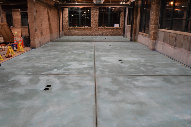 New Concrete Floor In Old Factory After Rinsing Excess Blue Acid Stain Residue