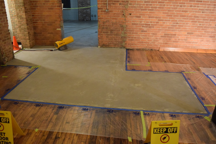 Damaged Concrete Slab Foundation After Resurfacing With Cement Overlay Base Coat
