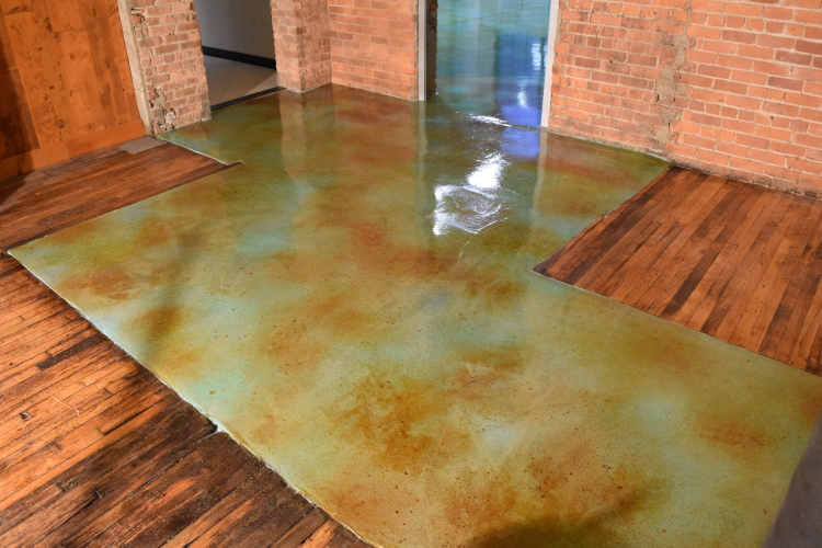 Acid-Stained Blue Cement Overlay Of Damaged Concrete Slab Foundation After Application of Clear Epoxy Sealer and Clear Acrylic Floor Finish