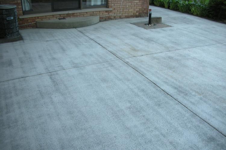 Shot-Blasted Backyard Concrete Patio Before Installing Decorative Concrete Overlay