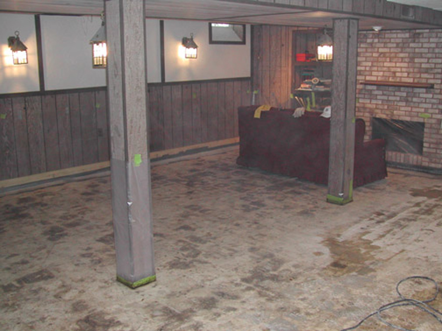Damp Basement Concrete Floor After Stripping Black Cutback Adhesive