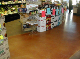 This acid-stained grocery store floor in the Detroit metro area has been well maintained with the use of floor finish.  Photo courtesy of:   Qualified Construction Corp