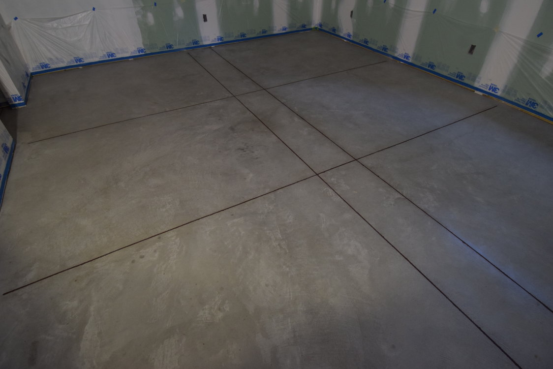 We filled the joints and saw-cuts on this new concrete floor with brown Metzger/McGuire RS 88 polyurea joint filler after cleaning and prior to acid staining.