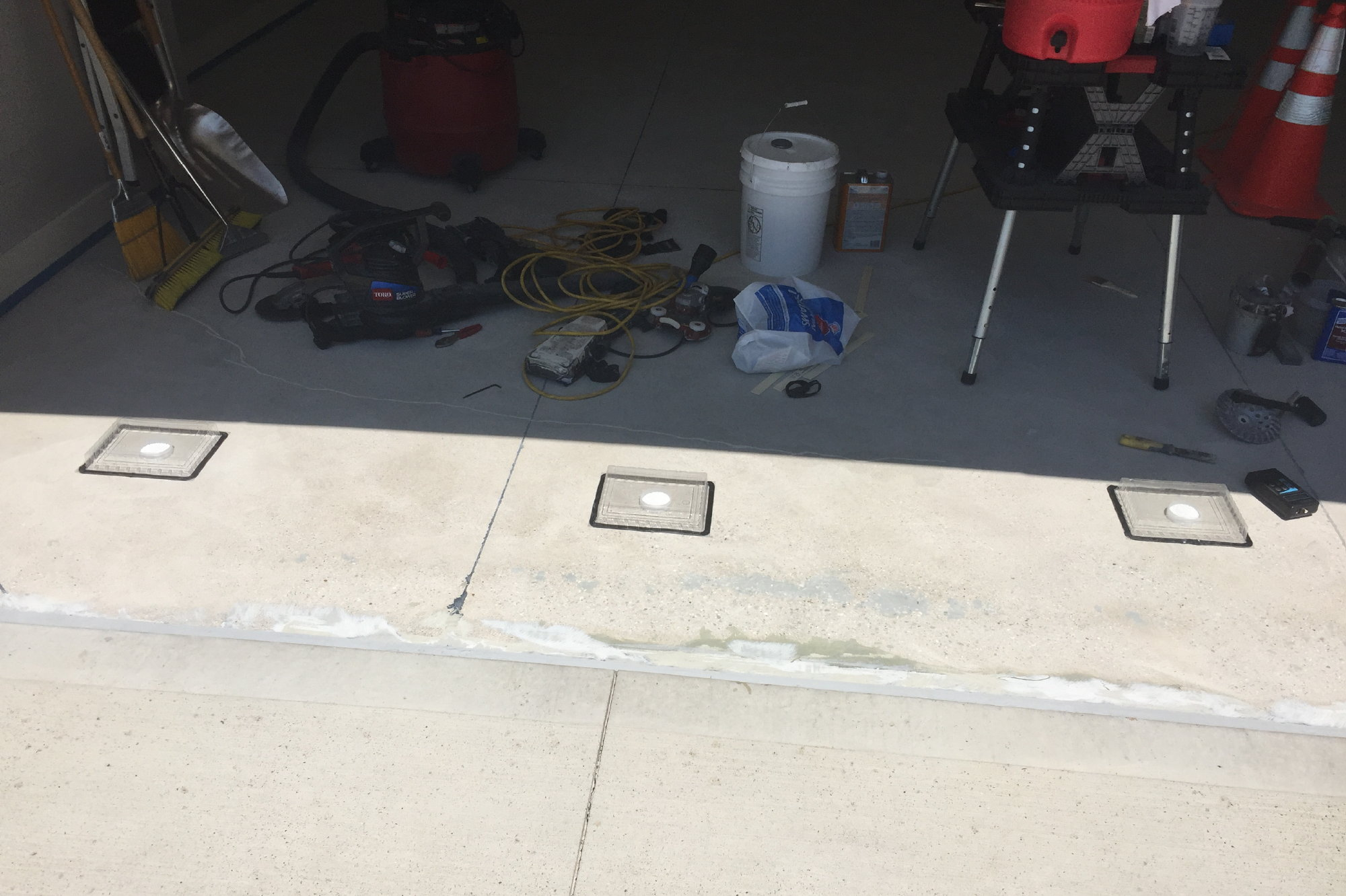 Excess moisture in this new garage floor due to improper rainwater drainage caused crumbling, pitting and cracking after only 2 years. Here, we are performing moisture vapor transmission testing to determine the extent of the problem.