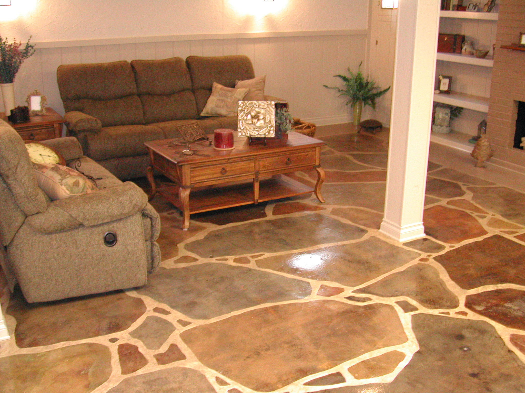 Award-winning acid-stained, faux finish, flagstone floor in residential finished basement, installed by Premier Veneers in 2002 after removing black cutback adhesive.