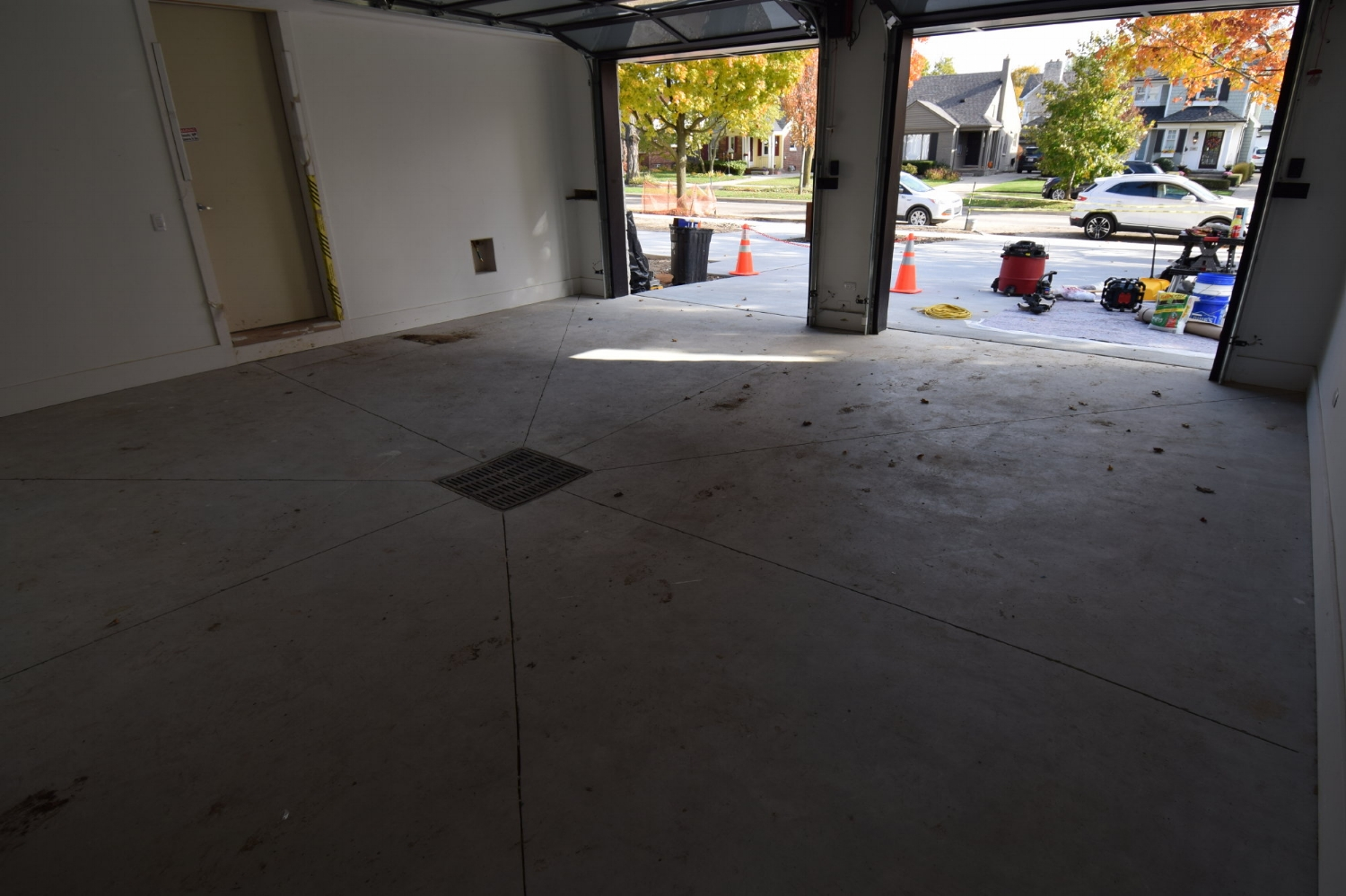Custom Home Garage Concrete Floor Before Cleaning And Acid-Staining