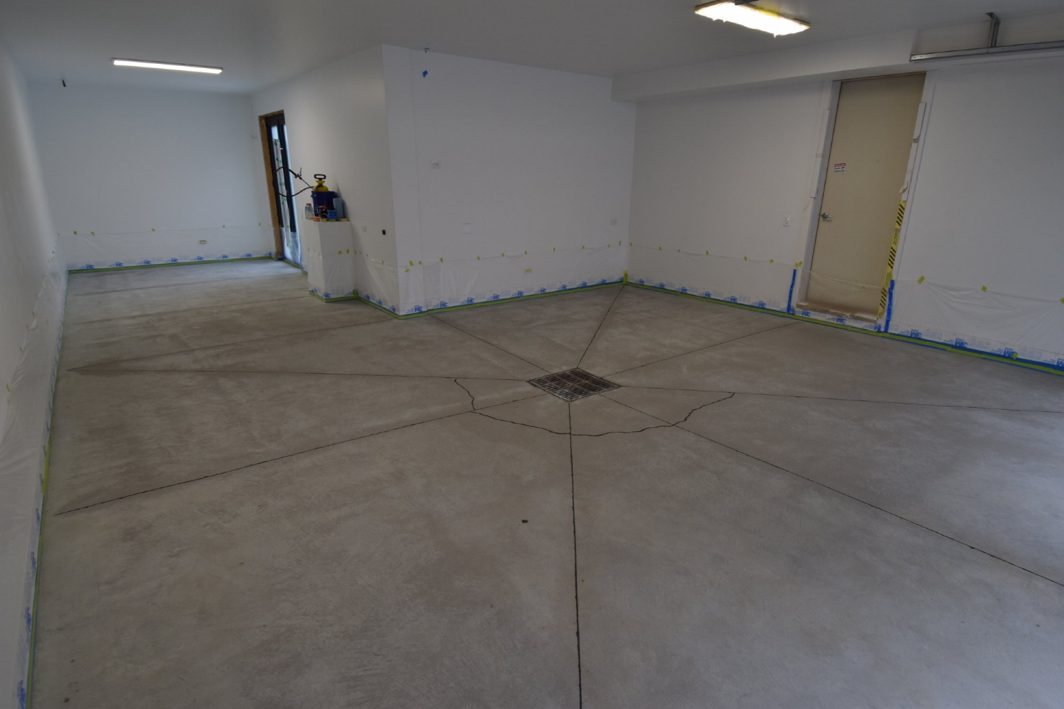Garage Concrete Floor After Cleaning And Filling Joints Before Acid-Staining