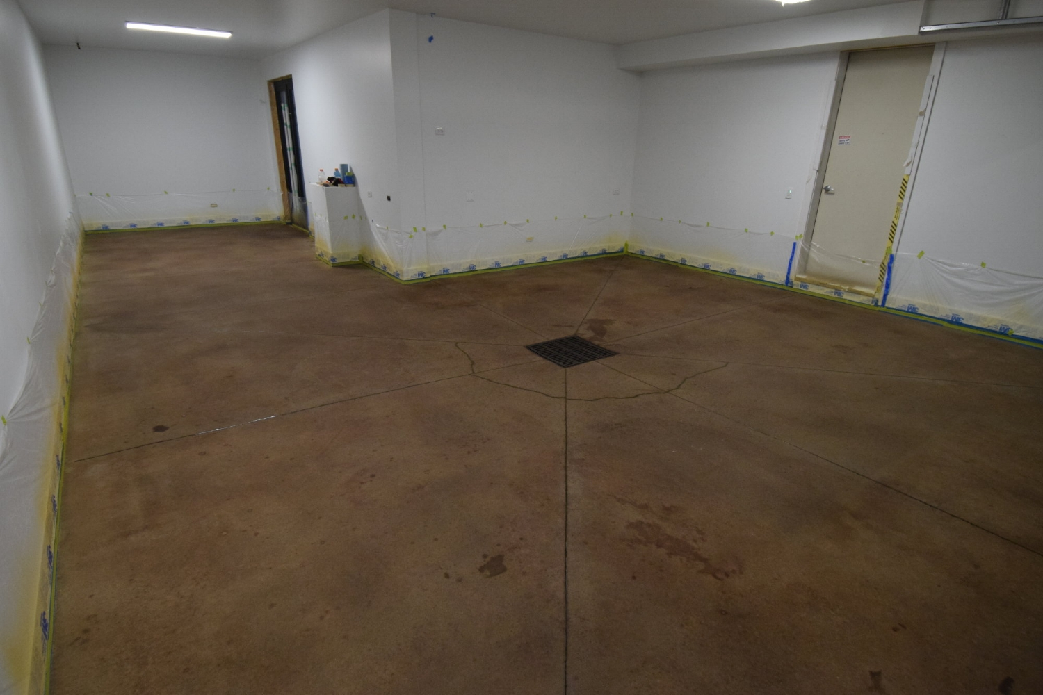 Garage Concrete Floor Just After Applying Dark Brown/Black Acid Stain