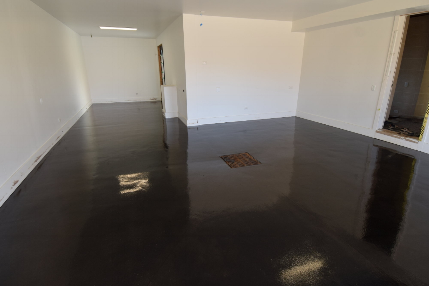 Black Acid-Stained Garage Concrete Floor With Clear Gloss Polyurea Sealer