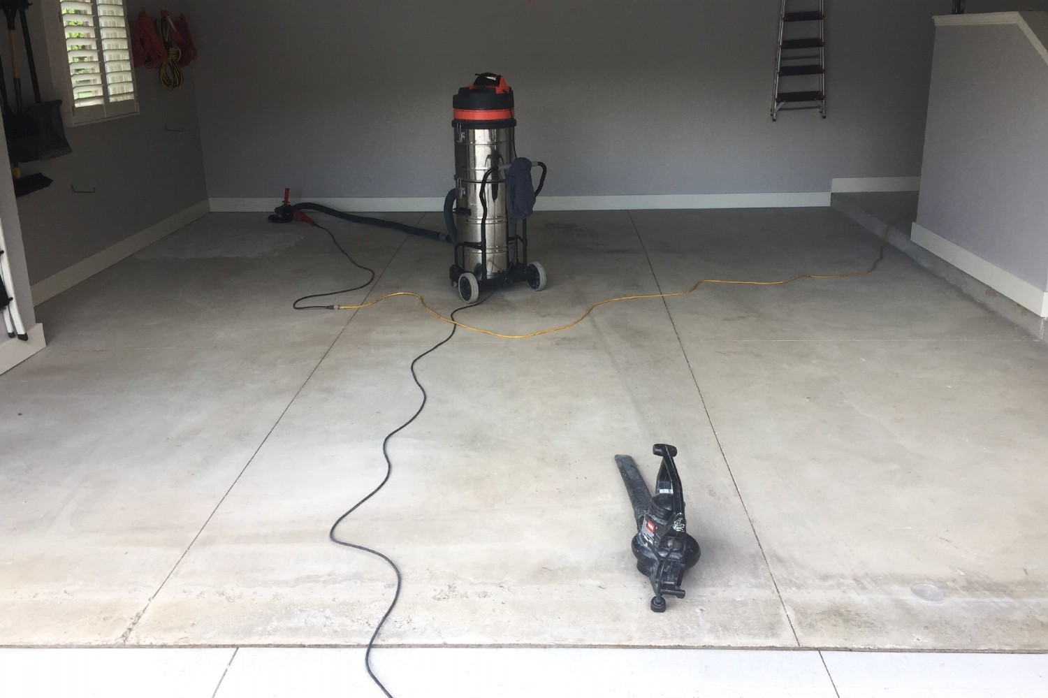 Garage Concrete Floor During Grinding To Clean Before Installing Polyurea Color Flake System