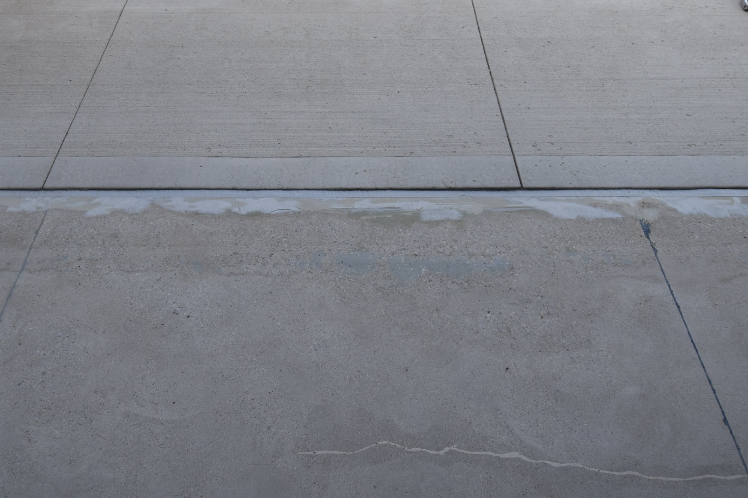 Closeup View of Garage Concrete Floor Joint Repair Before Installation of Polyurea Color Flake Coating
