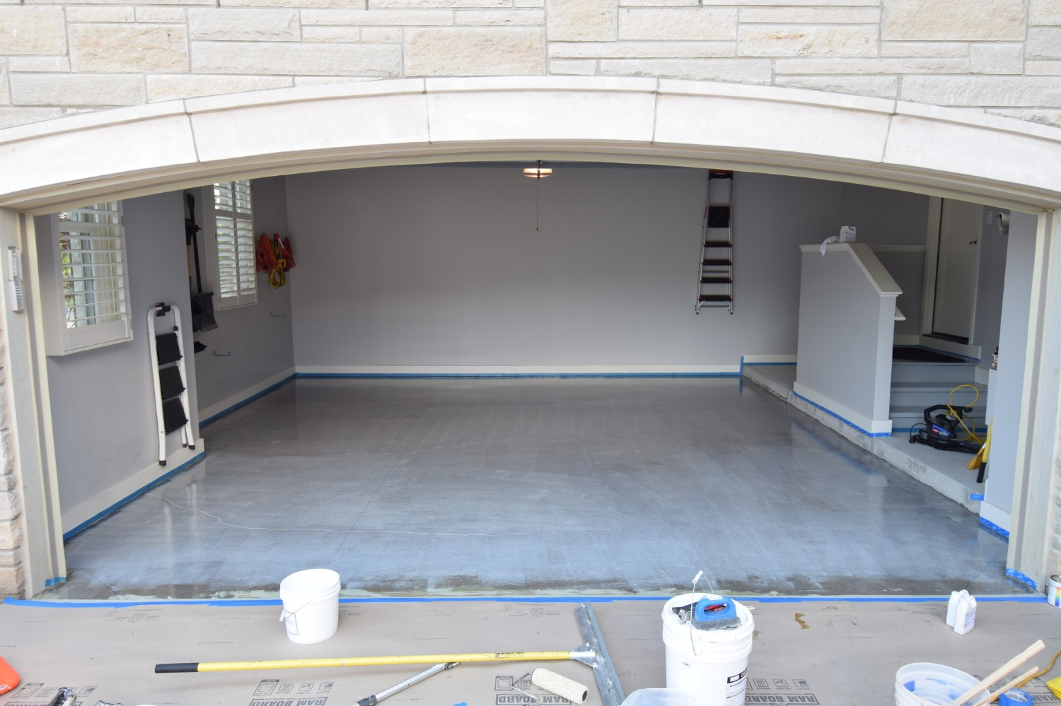 Garage Concrete Floor During Application Of Moisture Barrier Primer Coating