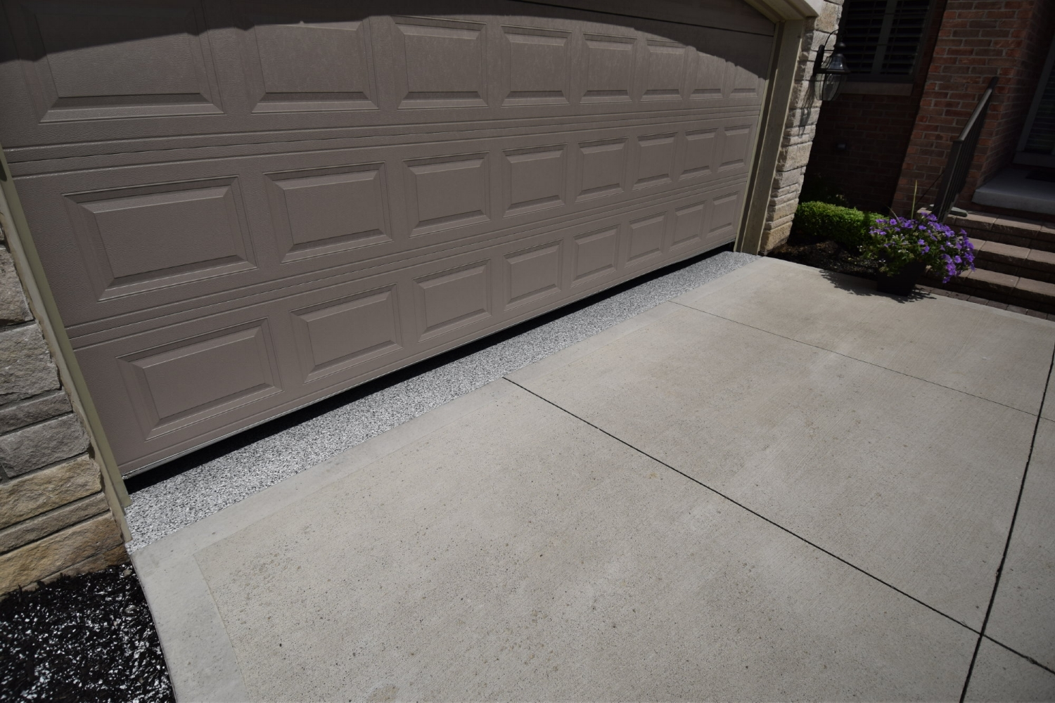Exterior Detail Of Garage Concrete Floor With Newly Installed Polyurea Color Flake Coating System