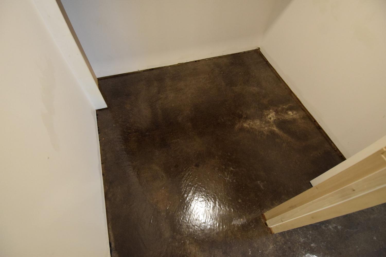 Black Acid-Stained Basement Concrete Floor Bedroom Closet With Clear Polyurea Sealer