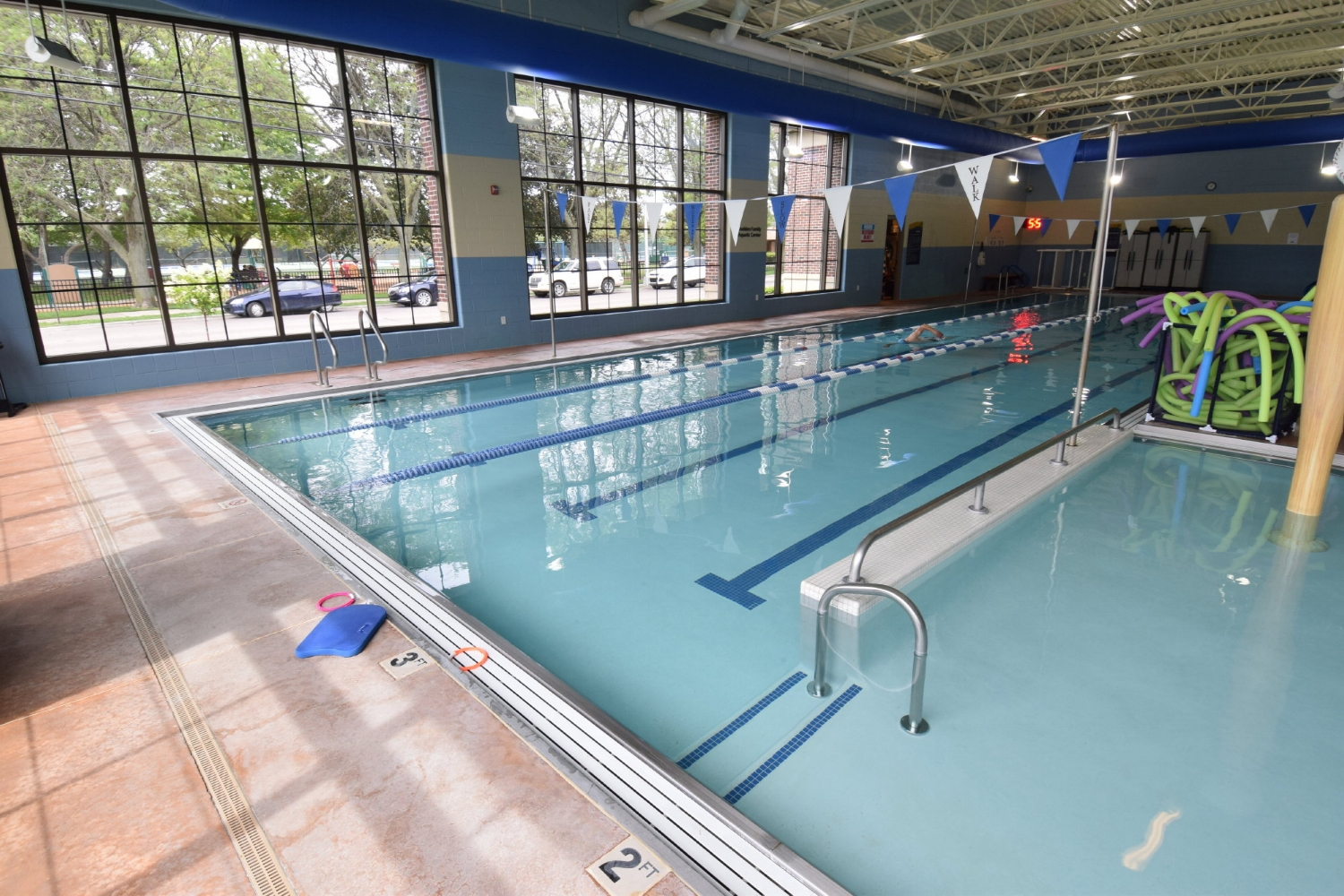 Commercial, Indoor Concrete Pool Deck Before Resurfacing With Spray-Texture Decorative Cement Overlay