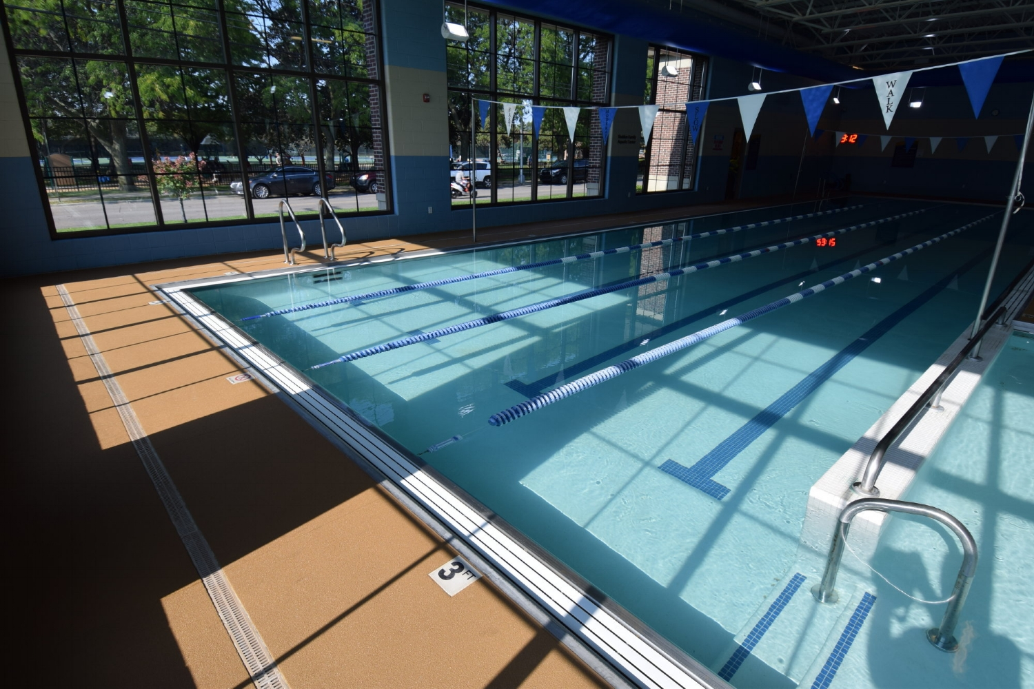 Commercial, Indoor Concrete Pool Deck After Resurfacing With Spray-Texture Decorative Cement Overlay