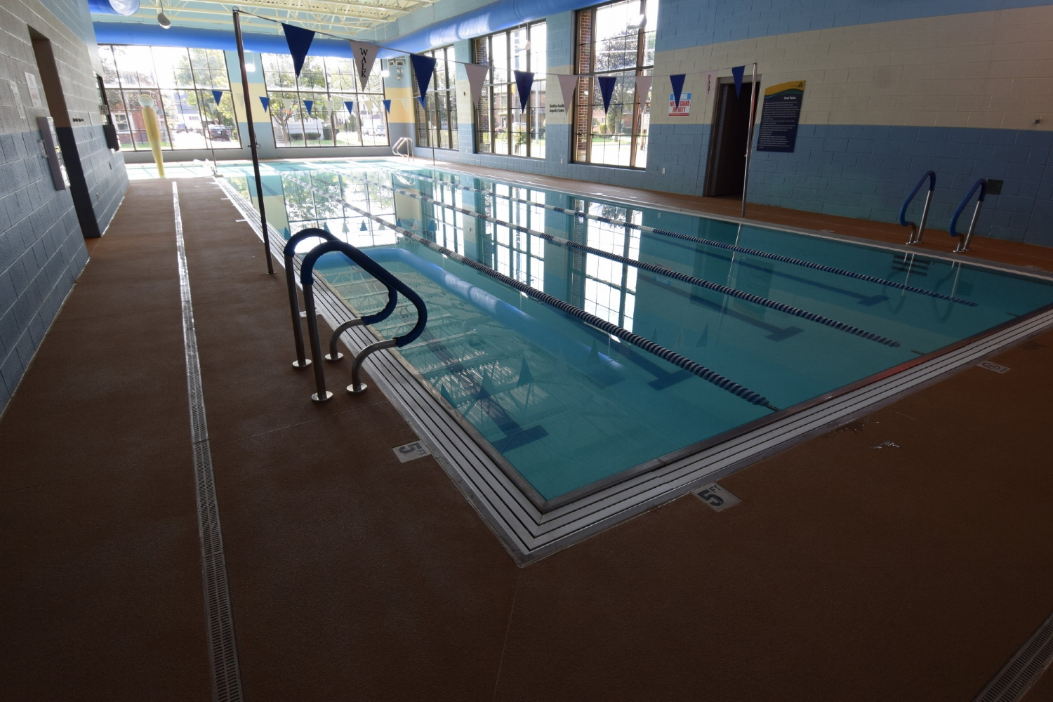 Commercial, Indoor Concrete Pool Deck After Resurfacing With Integrally-Colored, Spray-Texture, Decorative Cement Overlay